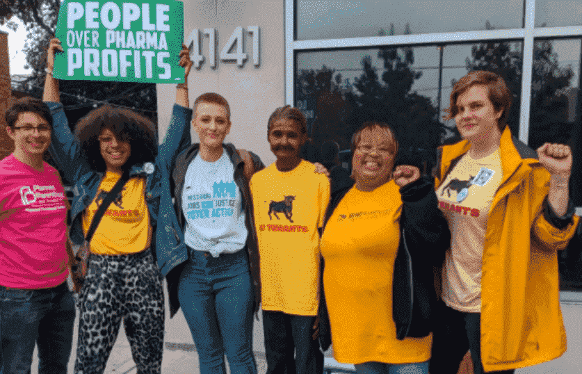 KC coalition of KC tenants, Jobs with Justice, Planned Parenthood, and sign with people over pharma
